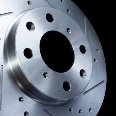 Disc brake on black background, Metal car brake disc with multiple cooling grooves. Automotive parts concept.