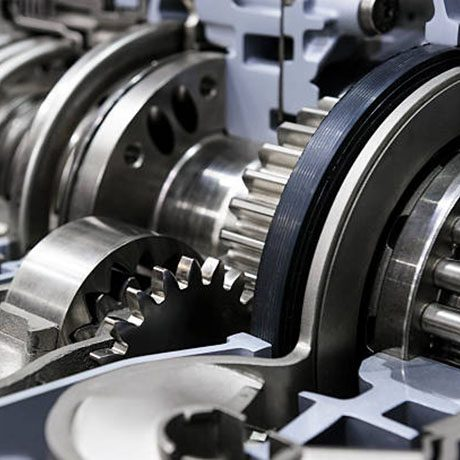 Gearbox cross-section, engine industry, sprockets, cogwheels and bearings of automotive transmission for oversize trucks, SUV, cargo, commercial and construction vehicles, selective focus